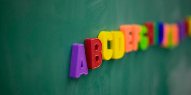 Magnetic alphabet letters on chalkboard